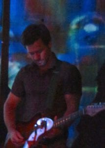 Dave Pomeranz playing guitar